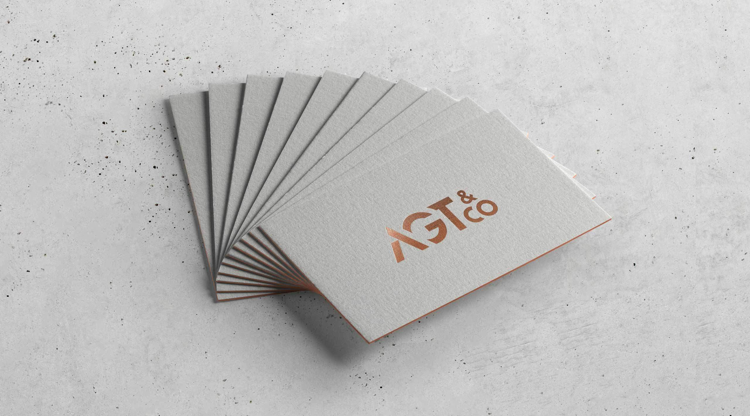 agt-co-copper-business-cards-on-concrete